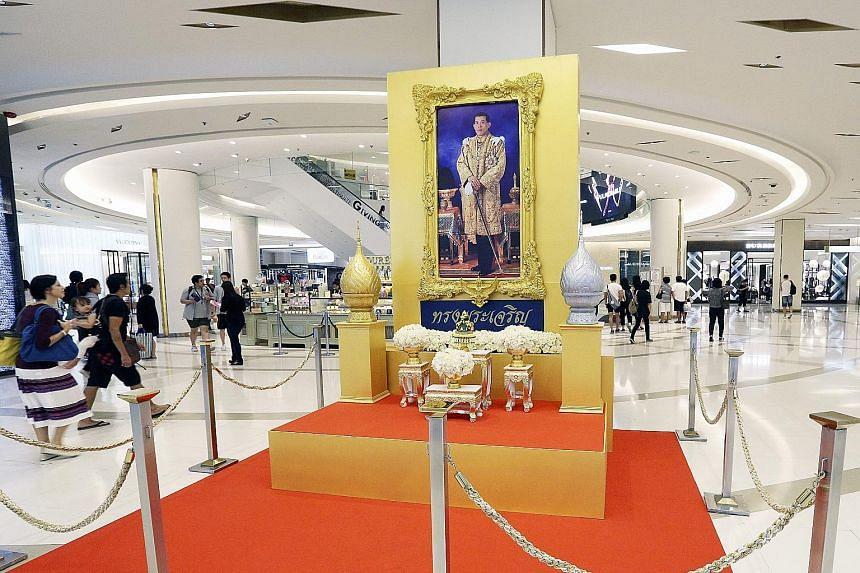 A portrait of King Maha Vajiralongkorn on display inside a shopping centre in Bangkok on Tuesday. King Maha Vajiralongkorn ascended to the throne last week.