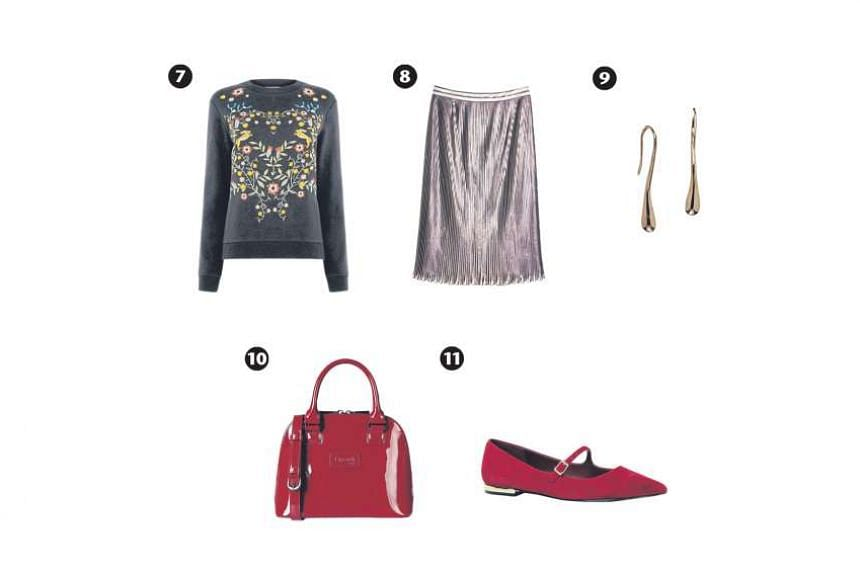 A metallic midi skirt looks demure and glamorous at the same time. Pair it with accessories that are just as shiny, such as a patent-leather bag, to up the glam factor. Embroidered sweater (photo 7), $119, from Warehouse; metallic skirt (photo 8), $1