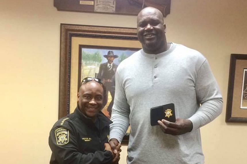 Former basketball star Shaquille O'Neal (right) in a photo from Sheriff Victor Hill's Facebook page.