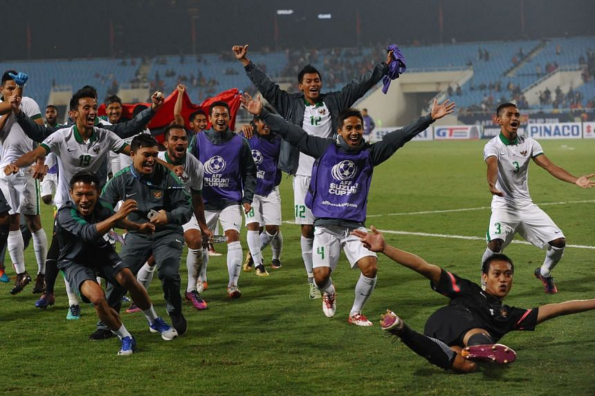 The Indonesian players celebrating after the final whistle. It took an extra-time penalty to equalise at 2-2 to put them through to the AFF Cup final 4-3 on aggregate.