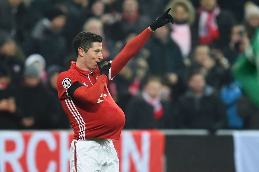 Bayern Munich striker Robert Lewandowski dedicating his winner to his pregnant wife and unborn child during the Champions League match against Atletico Madrid.