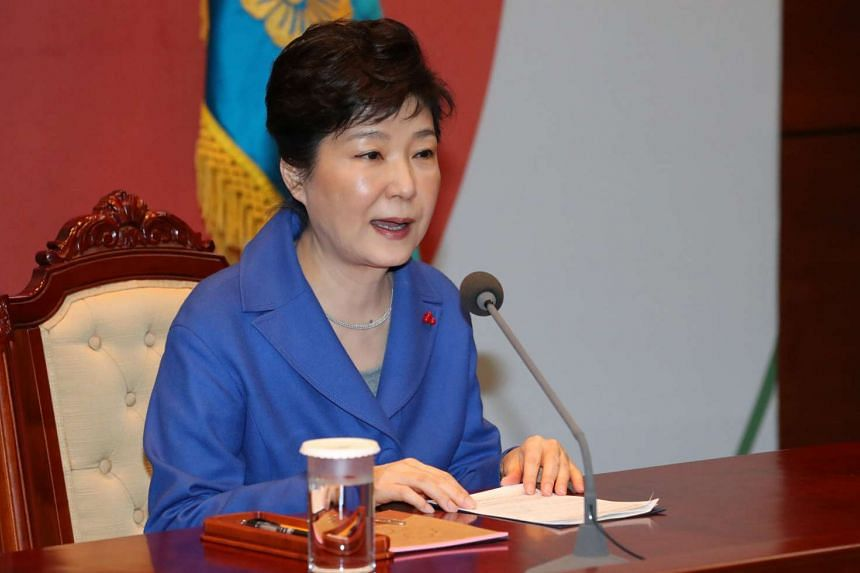 South Korean President Park Geun Hye speaks during an emergency cabinet meeting at the Presidential Blue House in Seoul on Dec 9, 2016.