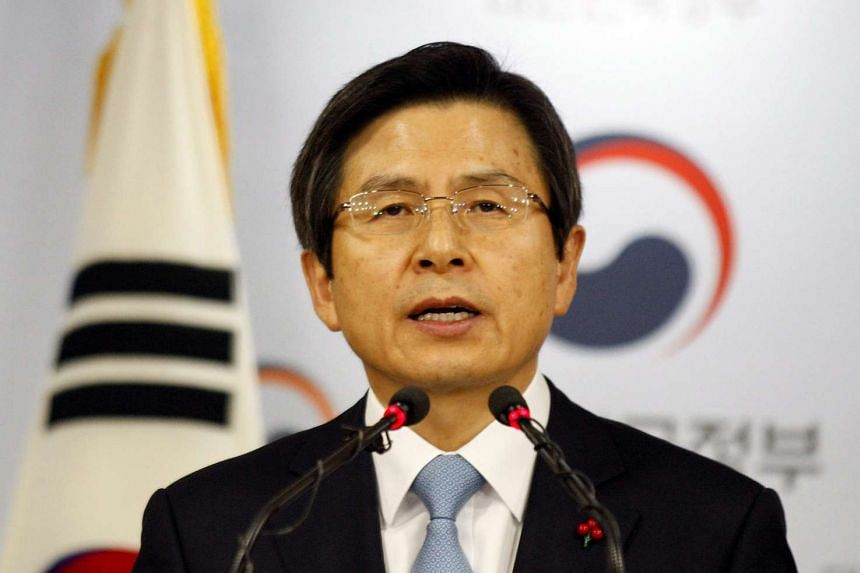 South Korean Prime Minister Hwang Kyo Ahn speaks during an address to the nation at the Integrated Government Building in Seoul on Dec 9, 2016.