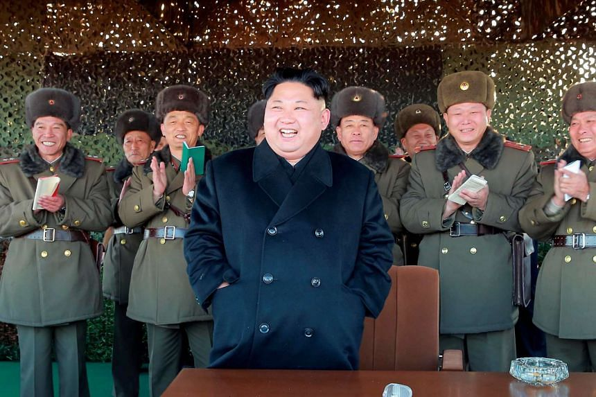 North Korean leader Kim Jong Un attends an armed forces artillery drill in an image released on Dec 2, 2016.