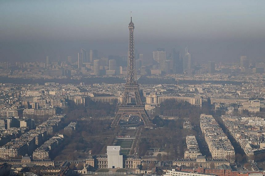 Paris' famous Eiffel Tower shrouded in a greyish haze, as the French capital experienced the worst air pollution in a decade due to a lack of winds. The city has implemented a ban on cars for the third consecutive day, based on whether their licence