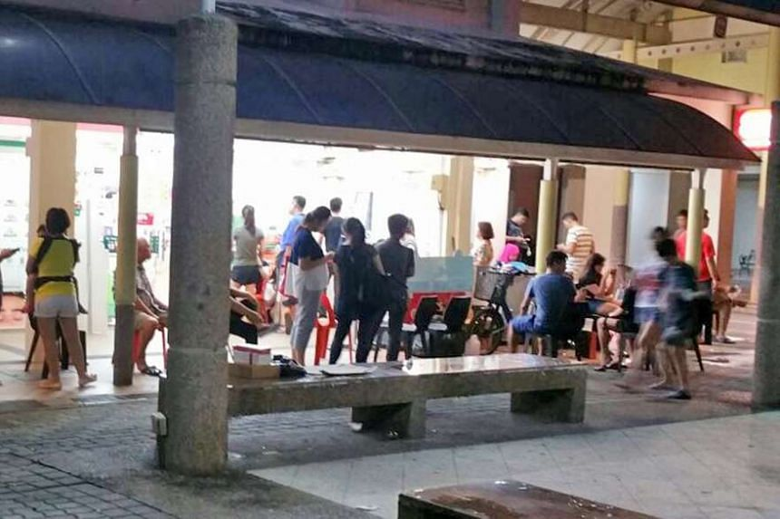 Customers queueing from midnight on Friday (Dec 9) at the 7-Eleven store at Block 807, Yishun Ring Road.