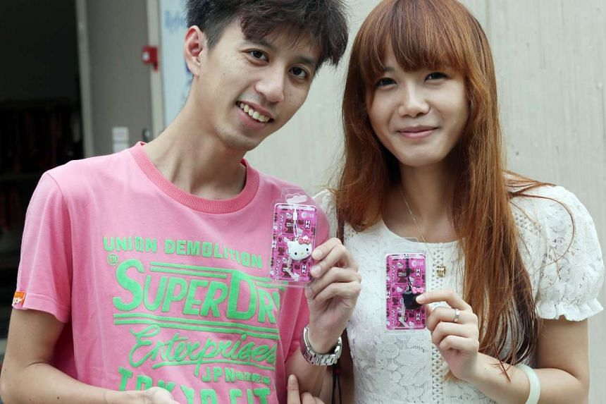 Happy customers pose with their Hello Kitty EZ-Charms.
