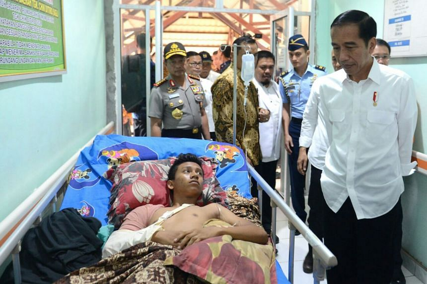 Indonesia President Joko Widodo visits people injured in the Aceh earthquake at the Tgk Chik Ditiro Sigli Hospital in Sigli, Aceh, on Friday (Dec 9).