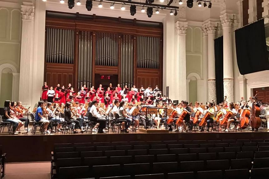 Members of the Singapore Symphony Children's Choir at a soundcheck for the pre-tour concert with Singapore National Youth Orchestra, on Dec 7, 2016.