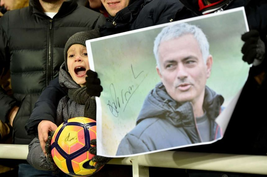 A young fan of Manchester United FC shouts near a portrait of the coach Jose Mourinho during the match between FC Zorya Luhansk and Manchester United FC, on Dec 8, 2016.