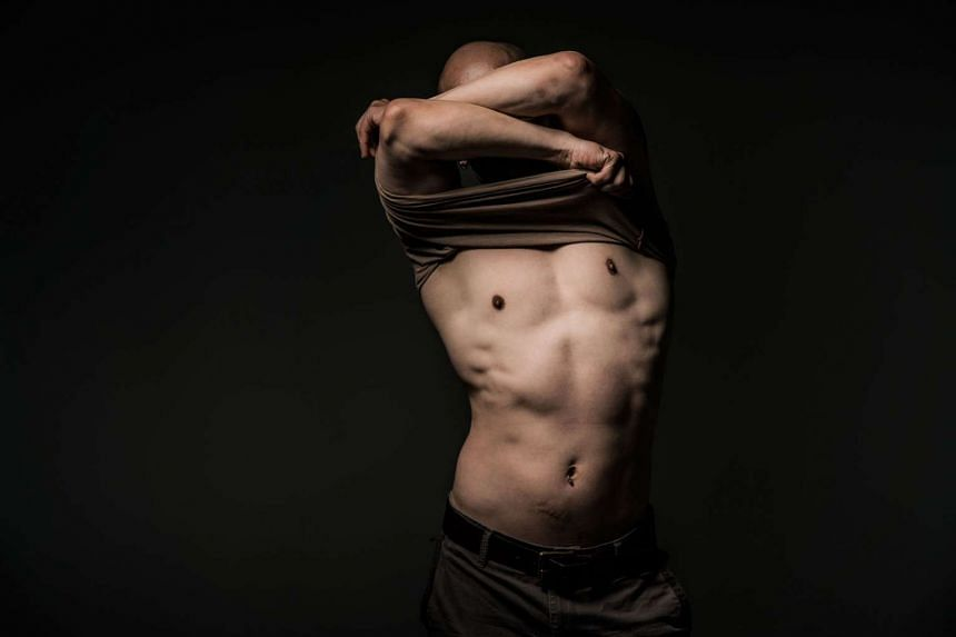 """The M1 Singapore Fringe Festival cancelled Undressing Room rather than cut what IMDA called """"excessive nudity"""". The show by Singaporean dancer Ming Poon has a dancer and a ticket holder undress each other in private."""
