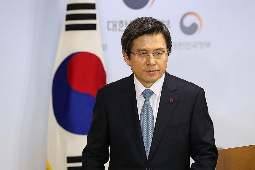 """In his first national address on Friday, Mr Hwang called for national unity to and promised to """"put every ounce of my energy into bringing state affairs under stable management""""."""