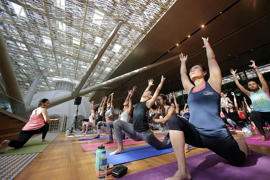 People taking part in a charity yoga session at the National Gallery Singapore yesterday. The 1½-hour class was led by instructors from local studios, The Yoga Mandala, Yoga Lab and Outta Hatha. About 50 people paid an entrance donation of at least