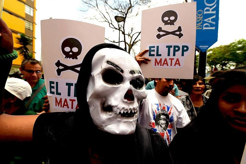 Protesters rally against the Trans-Pacific Partnership on the sidelines of the Apec Summit in Lima last month. Asia-Pacific leaders were urged to defend free trade from rising protectionism after Mr Donald Trump clinched the US presidency on a platfo