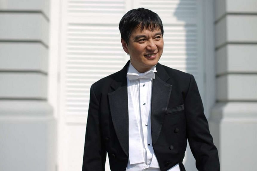 Director Shui Lan led the Singapore Symphony Orchestra at the Victoria Concert Hall last Friday.