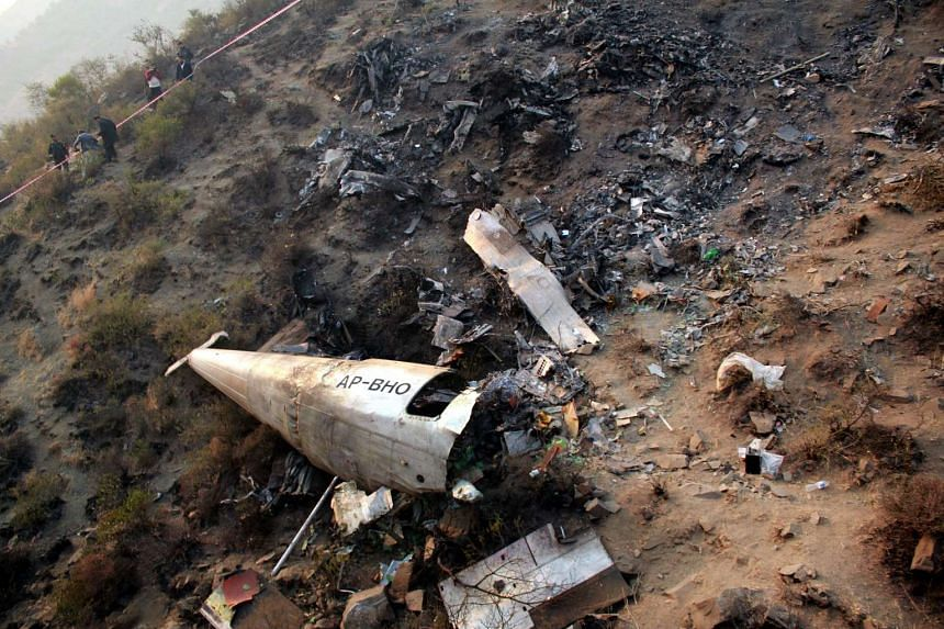 Local residents gathering near the wreckage of a Pakistan International Airlines (PIA) ATR 42 plane after it crashed near Havelian, Pakistan, on Dec 8, 2016.