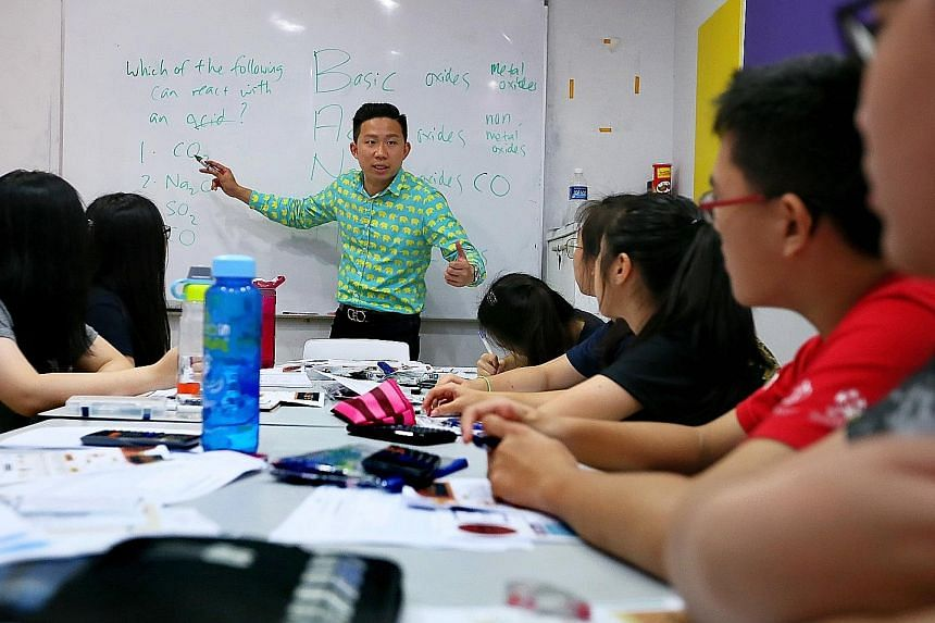 Bright Culture founder Joel Liu during a chemistry session with secondary students. He said the holiday period is crucial for those taking major exams next year.