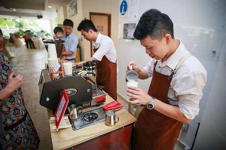 Olla Specialty Coffee owner Mr Lee (right) and barista Mike Ang serving coffee from a cart at a wedding in 2014. The coffee cart business here has grown, from just two to three companies in 2011 to about 20 now.
