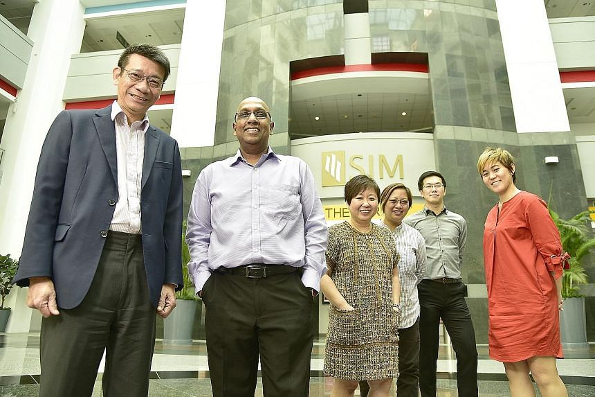 The team involved in setting up SIM's new international school includes (from left) Dr Lee, Mr Balamurugan, Ms Clare Wee, Ms Darrell Foo, Mr Kenneth Chee and Ms Wang Li-Sa. The school curriculum will focus on preparing students for the International