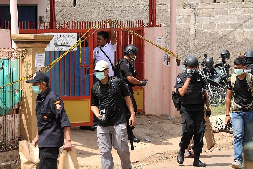 A boarding house in Bekasi, West Java, that was raided by Densus 88 on Saturday. The counter-terrorism unit detained a female suspect with a 3kg bomb encased in a pressure cooker. Three other suspects were arrested in separate raids that day, and a m