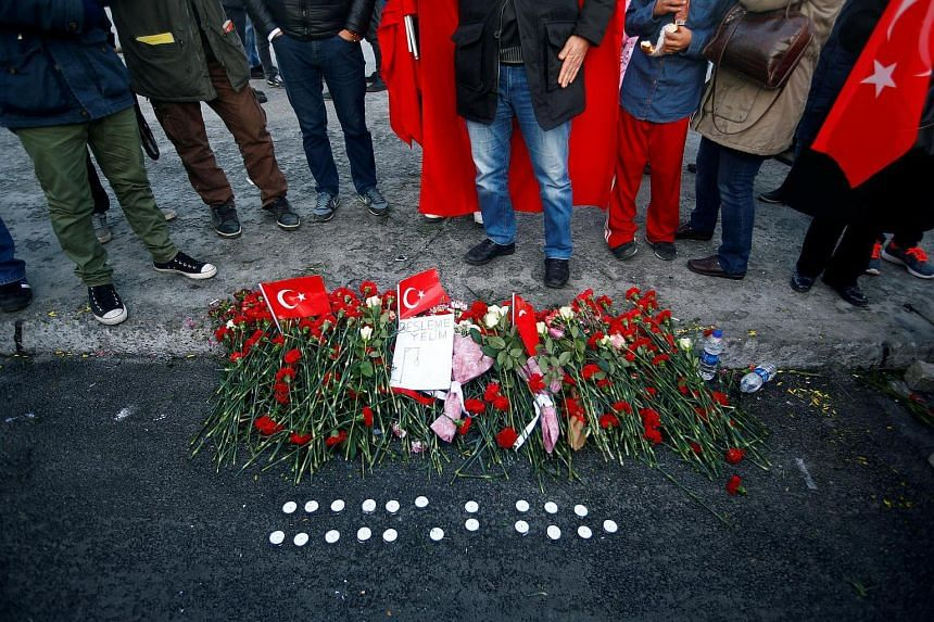 Flowers are seen at the scene of Saturday's blasts in Istanbul, Turkey on Dec 11, 2016.