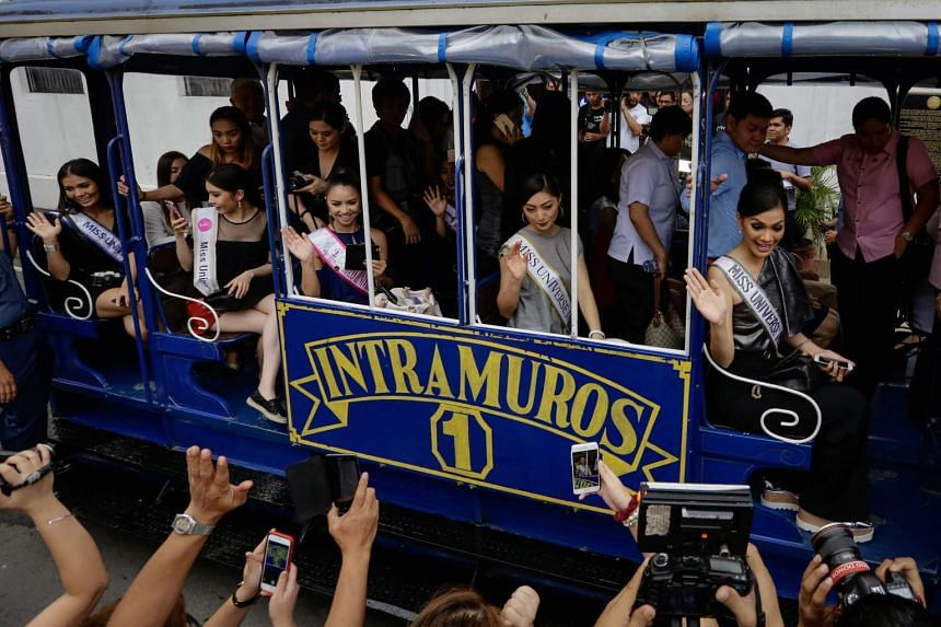 Miss Universe contestants riding a tram after visiting a museum in Manila on Dec 12, 2016.