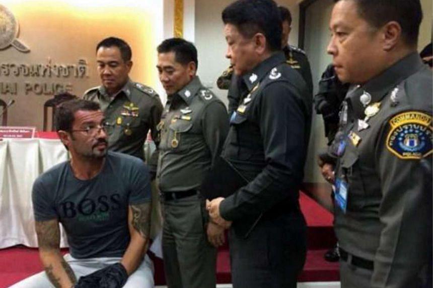 Swiss national Andre Xavier Justo (seated) is among those who received a royal pardon from new Thai King Maha Vajiralongkorn Bodindradevarangkun.