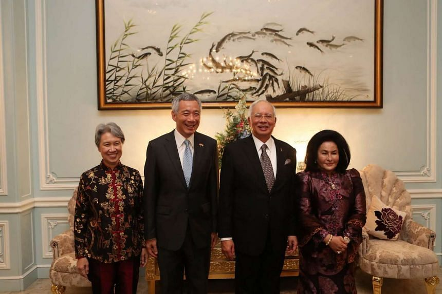 From left: Prime Minister Lee Hsien Loong's wife Ho Ching, PM Lee, Malaysian Prime Minister Najib Razak and his wife Rosmah Mansor at the dinner reception hosted by PM Najib at his official residence on Dec 13, 2016.