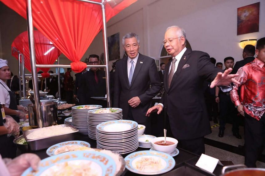 Prime Minister Lee Hsien Loong (left) with Malaysian Prime Minister Najib Razak at the dinner hosted by the latter on Dec 13, 2016.