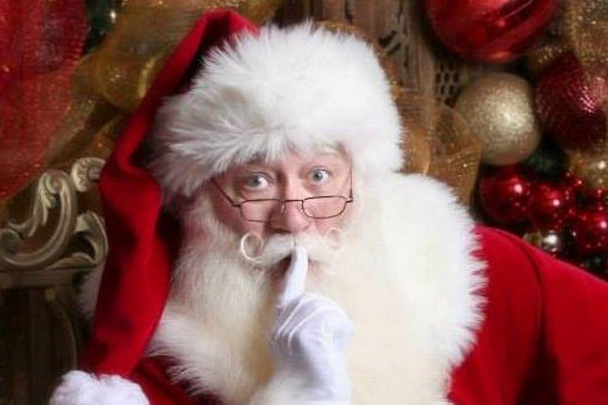 Eric Schmitt-Matzen smiles in a happier moment while posing as Santa Claus.