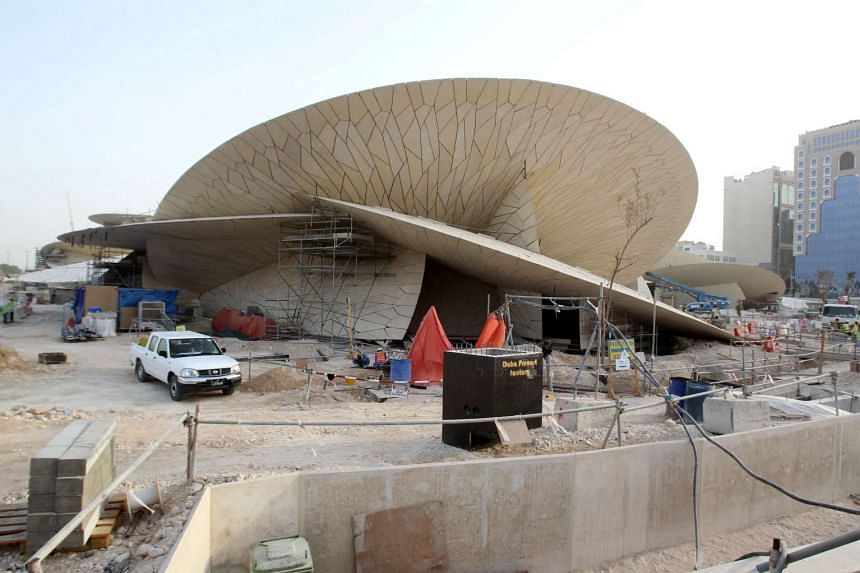 Labourers work at a construction site in National Museum of Qatar in Doha, Qatar.