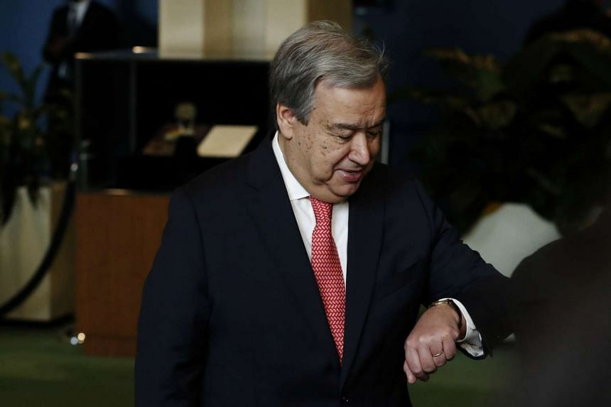 The new United Nations Secretary-General Antonio Guterresm of Portugal checks his watch before answering questions from the media after his swearing in at UN headquarters in New York.
