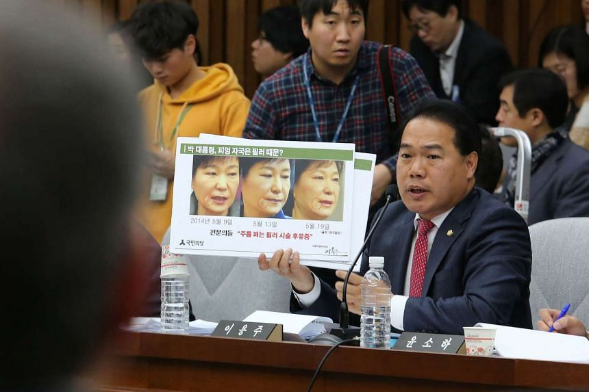 Opposition People's Party lawmaker Lee Yong Joo showing a combination of three images of impeached President Park Geun Hye during a hearing at the National Assembly in Seoul on Dec 14, 2016.
