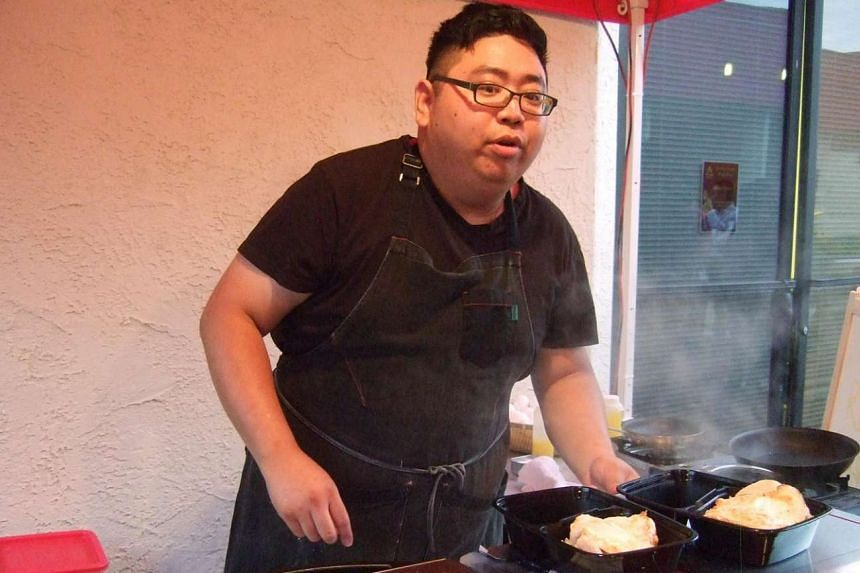 Chef Johnny Lee at his once-a-month chicken rice pop-up stall in Los Angeles' Chinatown area.