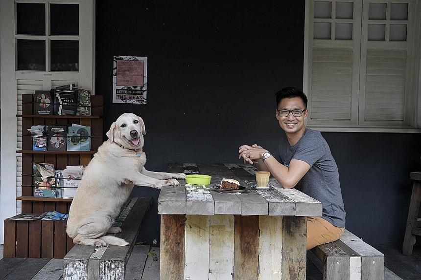 Pet Widget founder Ivan Loh and one of his two Labradors, Dawn. Once a Badge (above, right) is scanned with a smartphone, it will link to a profile on the Pet Widget platform, where you can get the owner's contact details, as well as other informatio