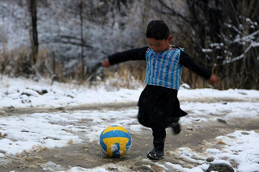 More than 10 months after Murtaza Ahmadi became an Internet sensation when pictures of him wearing an improvised Lionel Messi football shirt made from a plastic bag (above) went viral, the six-year-old Afghan boy finally got to meet his idol. Murtaza