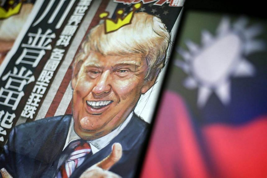 A newspaper headline with the illustration of US President-elect Donald Trump is pictured next to the flag of Taiwan in Taipei, Taiwan on Dec 12, 2016.