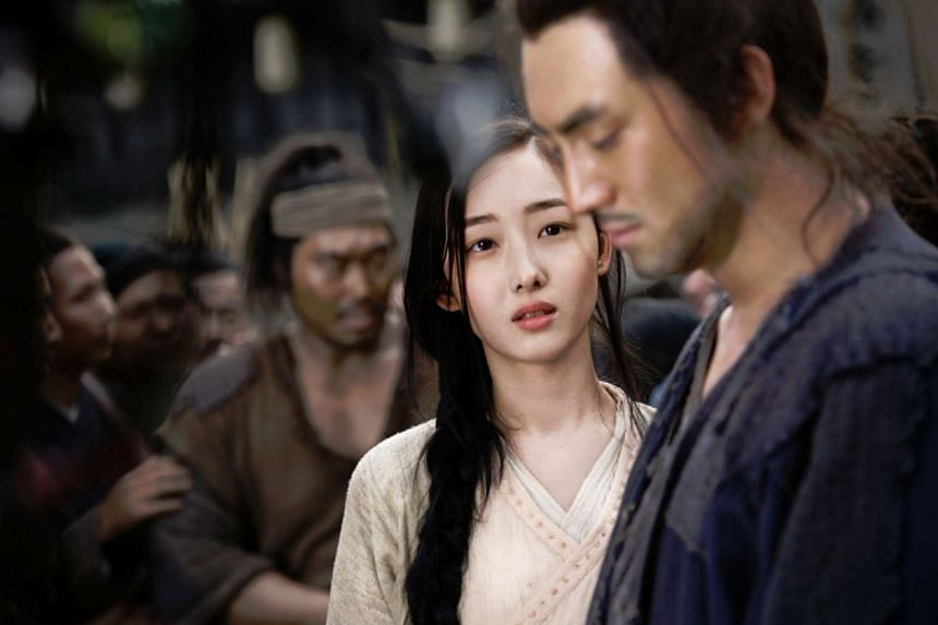 The love affair between Third Master (Lin Geng Xin, right) and prostitute Xiao Li (Jiang Meng Jie) is almost absent in Sword Master.