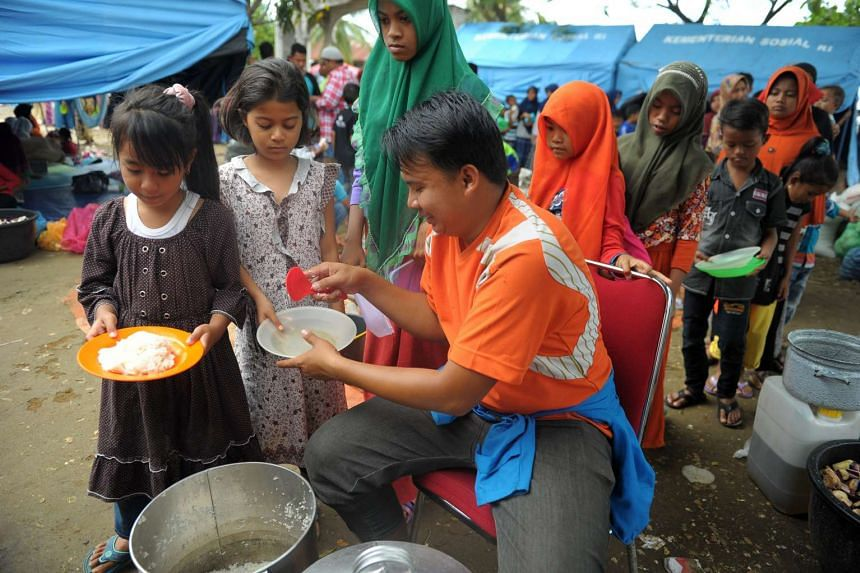 Displaced Acehnese at a shelter on Monday. The 6.5-magnitude quake killed over 100 people and destroyed thousands of homes, businesses and mosques. Food, clothing and sanitation products are urgently needed.