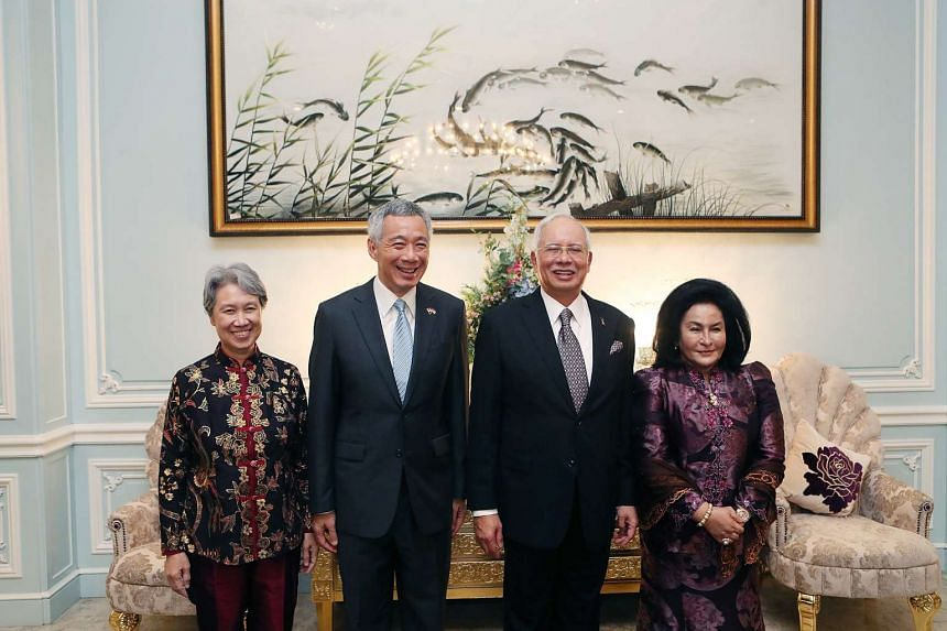 Above: PM Lee and Mrs Lee with Mr Najib and his wife Rosmah Mansor at Seri Perdana, where they had dinner yesterday.