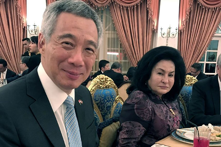 Mr Najib later posted this photo on Twitter with the caption: ''PM Hsien Loong enjoying our delicious Malaysian durian!''