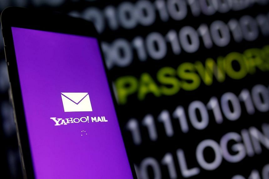 Yahoo's Mail logo is displayed on a smartphone's screen in front of code in this illustration picture.
