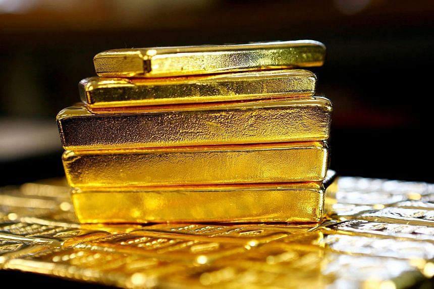 Gold bars are seen at an Austrian Gold and Silver Separating Plant. Gold prices fell on Thursday (Dec 15) to a new low in more than 10 months after the US central bank raised interest rates for the first time in a year.