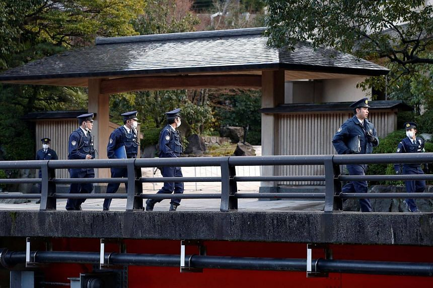 Police officers stand guard near a hot spring resort, the venue of the summit meeting between Japanese Prime Minister Shinzo Abe and Russian President Vladimir Putin, in Nagato, Yamaguchi prefecture, Japan on Dec 15, 2016.
