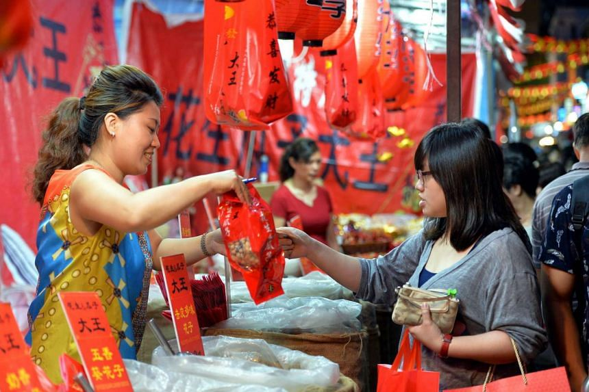 A shopper at the Chinatown Chinese New Year bazaar earlier this year in February.