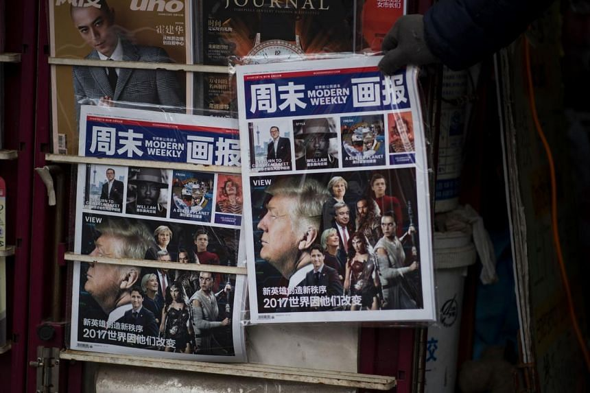A Chinese magazine featuring US President-elect Donald Trump on the cover is seen at a newsstand in Shanghai on Dec 14, 2016.