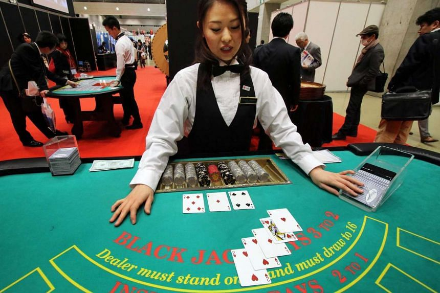 A dealer demonstrating how to play blackjack at a leisure exhibition in Tokyo, Japan.