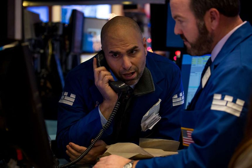 A trader works on the floor of the New York Stock Exchange (NYSE) in New York, US, on Dec 14, 2016.