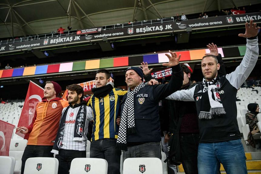 Besiktas, Fenerbahce, Galatasaray and Trabzon's supporters cheer prior to the Ziraat Turkish Cup football match between Besiktas and Kayserispor on Dec 14, 2016 at Vodafone arena stadium, in Istanbul.
