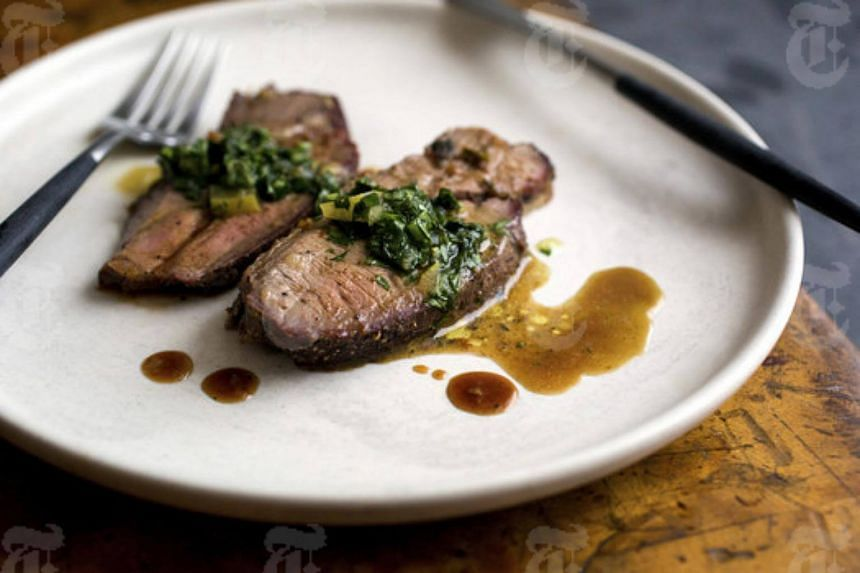 Butterflied and roasted leg of lamb, served with an herb and olive oil salsa verde studded with bits of preserved lemon.